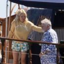 Queen's Roger Taylor uses a pole and shoots an AIRGUN at jellyfish whilst on a boat ride with his wife and children during sun-soaked holiday in Spain, 31 May 2019 - 454 x 554