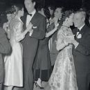 The couple on the dance floor of the Paris night club, Lido.  Audrey Hepburn and Mel Ferrer dance just off to their left side, 1955.