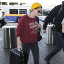 Kristen Stewart Arrives At Los Angeles International Airport