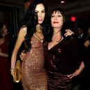 Mick Jagger and L'Wren Scott arrive at the Vanity Fair Oscar party hosted by Graydon Carter held at Sunset Tower on February 27, 2011 in West Hollywood, California