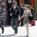 Funny Andy Samberg and Joana Newsom walking together in town