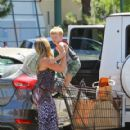 Hilary Duff picks up groceries with Luca on August 4, 2015