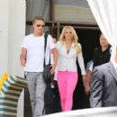 "Britney Spears and her fiance Jason Trawick leaving their hotel in Miami Beach for more work on ""The X-Factor"" (July 25)"