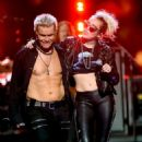 Miley Cyrus & Billy Idol at the 2016 iHeartradio Music Festival - 454 x 601