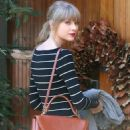 Taylor Swift kept a cheery face when she headed over to a friends house in Brentwood area of Los Angeles on Tuesday afternoon. (January 8)