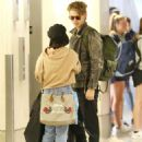 Vanessa Hudgens and Austin Butler at LAX Airport in LA - 454 x 598