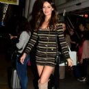 Nicole Trunfio in Overknee Boots and a Striped Mini Dress at the Airport in Sydney