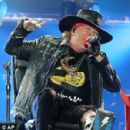 Put your feet up Axl! Rocker Rose puts on belting performance while confined to a chair as he joins AC/DC in Seville with his broken foot still in a cast - 306 x 298
