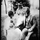 Portrait of Miss Keller with Anne Sullivan and Alexander Graham Bell in a garden. - 440 x 547